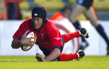LUSCOMBE OF WALES DIVES OVER THE LINE TO SCORE AGAINST THE BARBARIANS DURING THEIR INTERNATIONAL RUGBY ...