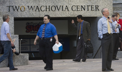Workers make their way near the Wachovia corporate headquarters in Charlotte