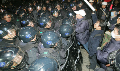 South Korean riot policemen block protesters at a rally in Seoul