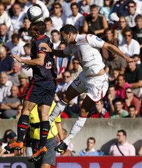 Erding of Paris St Germain challenges Rami of Lille during their French Ligue 1 soccer match at Parc des Princes stadium in Paris