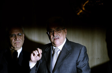 Palestinian President Abbas speaks next to Erekat, a top Palestinian negotiator, after meeting with Egypt's President Mubarak in Cairo