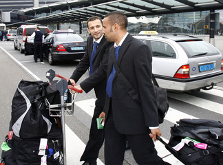 Skoko and Thompson of the Australian national soccer team arrives with the team at Schiphol Airport