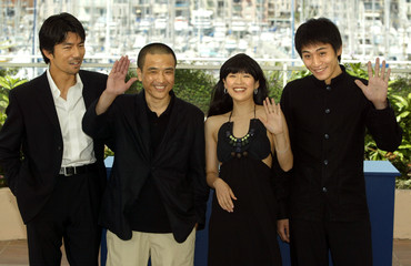 Chinese director You Le (2nd L) waves with Chinese actress Zhang Ziyi (2nd R) and Chinese actor Liou..