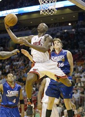 Miami Heat guard Wade drives to the basket against the Philadelphia 76ers in Florida.