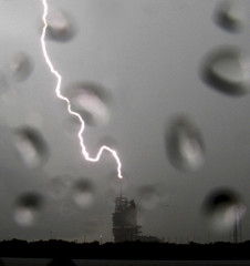Lightning strikes near the space shuttle Endeavour resting atop launch pad 39A during thunderstorms at the Kennedy Space Center in Cape Canaveral