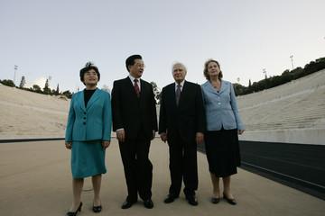 Chinese President Hu Jintao, his wife Liu Yongqing, Greek President Karolos Papoulias, his wife May Papoulias, pose in front of the ancient Panathinaiko stadium in Athens