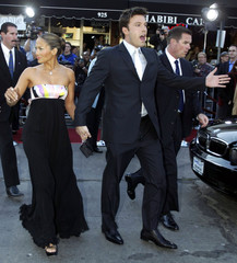 "Actor Ben Affleck, star of the new action film ""Daredevil"" and his fiancee, Jennifer Lopez cross the.."