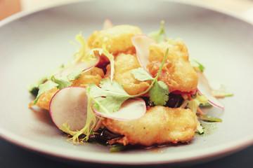 Fish tempura in grey porcelain plate, toned