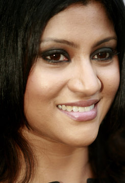 Bollywood actress Konkana Sen Sharma smiles during the launch of a new skin care product in Kolkata
