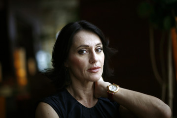 Romanian Olympic gold medal gymnast Nadia Comaneci poses during an interview with Reuters in Miami