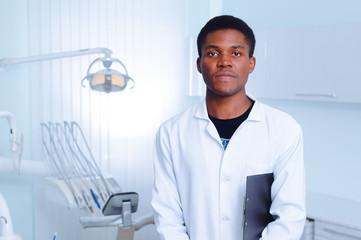 Black dentist in a dental clinic