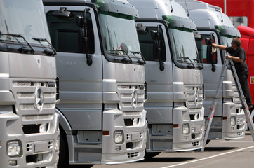 Man cleans McLaren Mercedes team trucks before British Grand Prix at Silverstone race track in central England