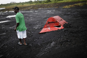 Victor Anthony, a resident, walks on the Pitch Lake in La Brea, south of Port of Spain