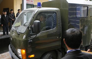 A police truck leaves the provincial People's Court while transporting Tran Anh Kim in Thai Binh province