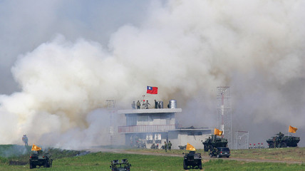Soldiers capture a mock enemy building at the Chingchuankang Air Force Base during a Han Kuang exercise drill in Taiwan