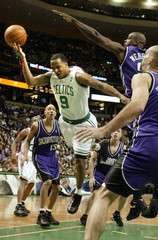 CELTICS BREMMER TRIES TO TAKE ON KINGS DEFENSE IN BOSTON.
