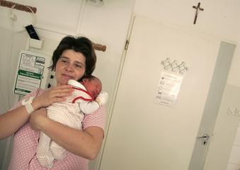 Edyta Dobrzanska holds her new-born baby Maciej at a hospital in Warsaw