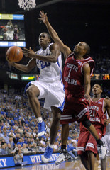 University of Kentucky's Meeks fights to get his shot off under pressure from University of South Carolina during play in their NCAA basketball game in Lexington