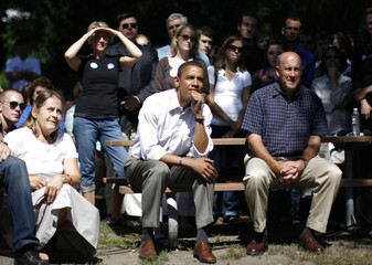 US Democratic presidential candidate Senator Barack Obama sits among supporters at a campaign event at Rod and Gun Park in Eau Claire, Wisconsin