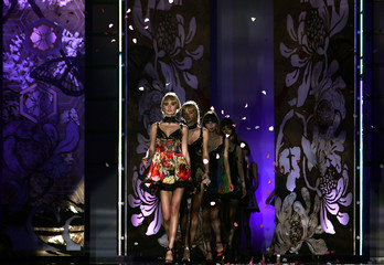Models present creations as part of Just Cavalli Fall/Winter women's collection during Milan Fashion Week