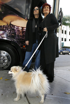 Ozzy and Sharon Osbourne and their dog Minnie arrive at an auction of some of their belongings in Beverly Hills