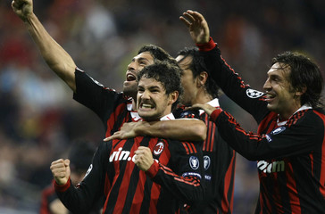 AC Milan's Pato celebrates his second goal with team mates during their Champions League match against Real Madrid in Madrid