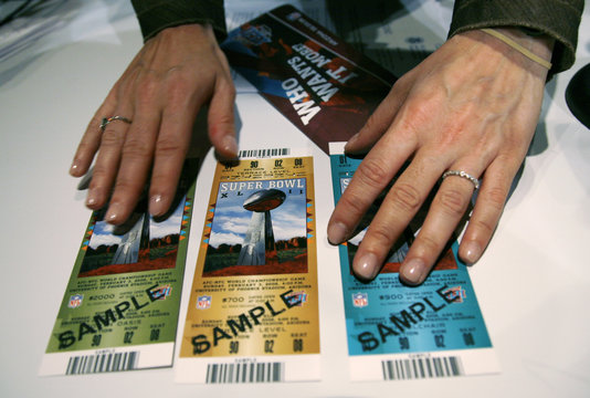 Samples of legitimate Super Bowl XLII tickets are displayed at a news conference in Phoenix