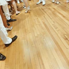 People's feet on parquet floor
