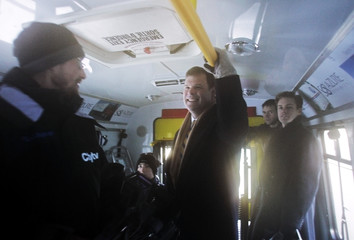 Canada's Environment Minister John Baird waits onboard a hybrid bus, to depart for a news conference in Ottawa
