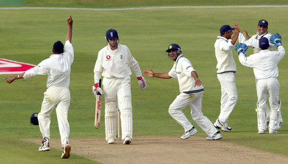 ENGLAND'S CRAWLEY WALKS BACK TO THE DRESSING ROOM AS INDIA CELEBRATEHIS WICKET DURING THE THIRD TEST AT ...