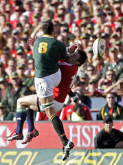 Tommy Bowe of the British and Irish Lions competes for a high ball with South Africa's Pierre Spies during the second rugby union test match in Pretoria