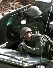 AN ISRAELI SOLIDER GUARD AS ARMY BULLDOZERS DEMOLISH THE RADIOTRANSMISSION STATION OF THE VOICE OF ...