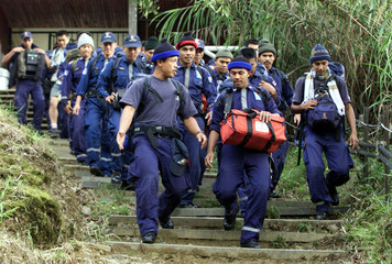 SPECIAL MALAYSIAN RESCUE TEAM BEGIN THEIR SEARCH FOR MISSING BRITISHGIRL AT MOUNT KINABALU.