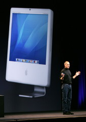 Apple CEO Steve Jobs introduces the new version of Apple's iMac computer at the Macworld Conference ..