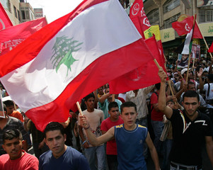 Supporters of the Popular Front for the Liberation of Palestine march with Lebanese flags in Ramallah
