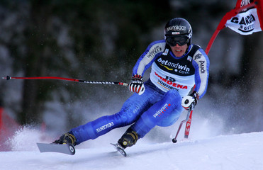 Switzerland's Kernen clears a gate on his way to ninth place in the Ski World Cup men's Super-G race ...