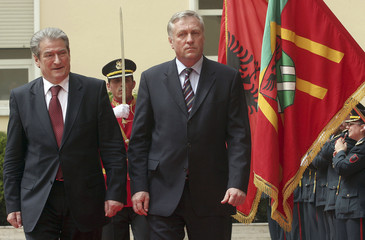Albania's Prime Minister Sali Berisha and his Czech counterpart Mirek Topolanek inspect the honour guard during a welcoming ceremony in Tirana