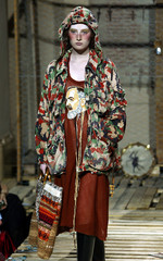 A model display an outfit bearing the face of Italy's favourite saint Padre Pio as part of Alexsandr..