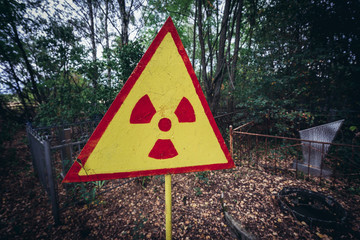 Radioactive sign on a cemetery in Pripyat city of Chernobyl Exclusion Zone, Ukraine