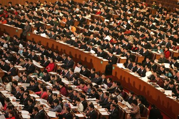 Chinese delegates attend the opening ceremony of NPC in Beijing