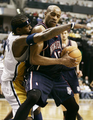 Indiana Pacers Jackson guards Nets Carter closely during NBA game in Indianapolis