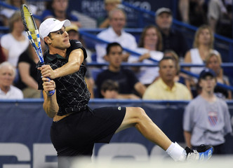 Roddick leans back on the follow-through on a shot against compatriot Isner during their semi-final match in the Legg Mason Tennis Classic in Washington