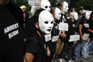 Attendees take part in a protest on the steps of the state capitol in Denver, Colorado