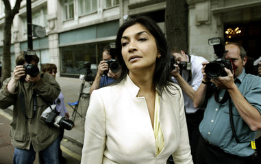 Former secretary at the English Football Association Alam leaves an industrial tribunal in London.