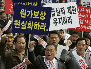 Protestors chant slogans at a rally near parliament in Seoul