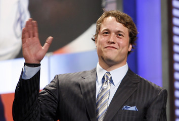 Quarterback Stafford from the University of Georgia walks on stage before being selected by the Detroit Lions as the number one overall pick in the 2009 NFL Draft in New York