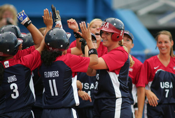 Nuveman of the US celebrates home run in Olympic softball match in Athens.
