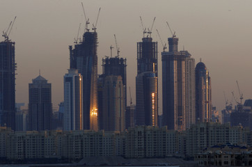 Dubai Marina's tower blocks rise over the Shoreline Apartments on Nakheel's Palm Jumeirah in Dubai