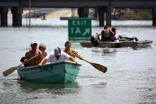 Members of search and rescue teams help evacuate people trapped in flooded homes in Baton Rouge.