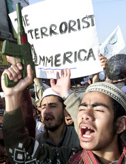 A SUPPORTER OF MUTTAHIDA MAJLIS-E-AMAL HOLDS A TOY GUN AS HE CHANTSANTI-US SLOGANS DURING A ...
